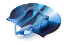 Simninglock och goggles royaltyfri foto
