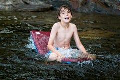 Simningpojke Fotografering för Bildbyråer