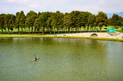 Simon Bolivar Park. BOGOTA, COLOMBIA - FEBRUARY 6, 2014: A view of the lake of the Simon Bolivar Park in Bogota, and a person kayaking on it Stock Image