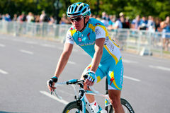 Simon Clarke from Astana leaving the race. At the Urban Grand Prix Cycliste du Quebec a Montreal (GPCQM) at the end of the summer, early fall 2011 on September Royalty Free Stock Photo