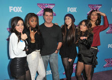 """Fifth Harmony,Simon Cowell. Simon Cowell & Fifth Harmony at the press conference for the season finale of Fox's """"The X Factor"""" at CBS Televison City, Los Angeles Stock Image"""