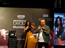 Simon shaw at beauty expo. Its photo of hair styling session by Hair stylist Itty Agarwal from Wahl. Mr. Simon Shaw was hosting the session.Event - Professional royalty free stock photos