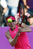 Simona Halep. Hits a backhand, during a tennis match counting for BRD Bucharest Open Wta Tour, BNR Arena, Bucharest, Romania, 9th July 2014 Stock Photography