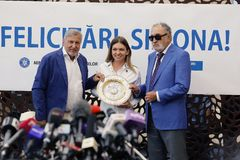 Simona Halep returns home with Wimbledon trophy, Press Conference. Simona Halep with Ilie Nastase and Ion Tiriac. Simona Halep Press Conference at Otopeni royalty free stock images