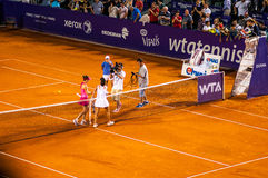 Simona Halep and Lara Arruabarrena salute after QF of Bucharest Open WTA. July the 11th, 2014, tennis match won by Simona Halep Royalty Free Stock Images