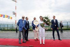 Simona Halep returns home with Wimbledon trophy. Mihai Covaliu, president of COSR, Comitetul Olimpic si Sportiv Roman and Bogdan Matei, Minister for Youth and royalty free stock photo