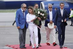 Simona Halep returns home with Wimbledon trophy. Mihai Covaliu, president of COSR, Comitetul Olimpic si Sportiv Roman and Bogdan Matei, Minister for Youth and royalty free stock image
