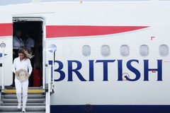 Simona Halep returns home with Wimbledon trophy. Simona gets off British Airways plane stock images