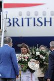 Simona Halep returns home with Wimbledon trophy. Simona gets off British Airways plane stock image