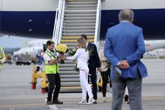 Simona Halep returns home with Wimbledon trophy. Simona gets off British Airways plane stock photo