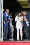 Simona Halep returns home with Wimbledon trophy. Simona gets off British Airways plane stock photography