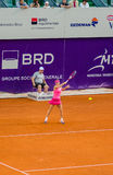 Simona Halep warming up for the QF of Bucharest Open WTA. Simona Halep during the QF of Bucharest Open WTA, July the 11th, 2014, tennis match between Simona Stock Image