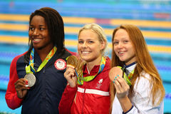 Simone Manuel L USA, Pernille Blume DNK and Aliaksandra Herasimenia BLR during medal ceremony after Women`s 50 metre freestyle. RIO DE JANEIRO, BRAZIL - AUGUST stock photo
