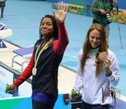 Simone Manuel of USA and Aliaksandra Herasimenia of Belarus during medal ceremony after Women`s 50m freestyle of the Rio 2016. RIO DE JANEIRO, BRAZIL - AUGUST 13 royalty free stock image