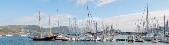 Simons Town harbor panorama. CAPE TOWN, SOUTH AFRICA - DECEMBER 12, 2014:  Simons Town harbor with two South African Navy Valour class frigates and S99, the SAS Royalty Free Stock Images