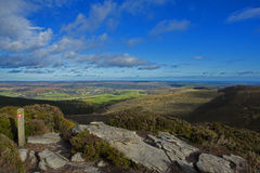Simonside Hills Rothbury Northumberland. A view from the top of Simonside over towards Rothbury in the valley and the coast of Northumberland in the distance Stock Images