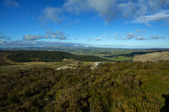 Simonside Hills Rothbury Northumberland. A view from the top of Simonside over towards Rothbury in the valley and the coast of Northumberland in the distance Stock Photo