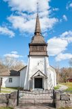 Countryside church during spring in Sweden. Simonstorp church in countryside of Ostergotland during spring in Sweden. This church was completed in 1650 Royalty Free Stock Photography
