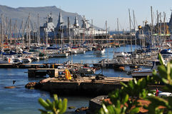 Simonstown harbour. Cape Town naval port of Simonstown with yacht moorings and frigate Stock Images