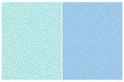 2 Simple Abstract Polka Dots Vector Patterns. White Irregular Brush Dots on a Light Blue Background. stock illustration