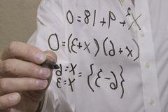 Simple algebra equation which illustrates two points on a curve or on a line. Mathamatician works on a formula to solve for  a problem in order to provide a stock photo