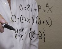 Simple algebra equation which illustrates two points on a curve or on a line. Mathamatician works on a formula to solve for  a problem in order to provide a royalty free stock photo
