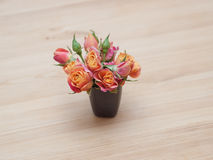 Simple arrangement from orange roses Royalty Free Stock Photography