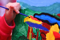 Simple Art. Small girl is paiting. Different point of veiw an art Royalty Free Stock Images