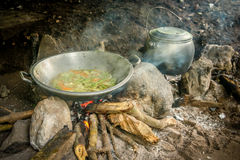 Simple asian meal. Pot and kettle with simple meal cooked by a porter on a trek in Lombok, Indonesia Royalty Free Stock Images
