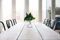 Simple background of a light bright contemporary dining room tab Stock Photo