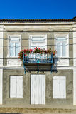 Simple balcony of a one-story house, with well maintained  old h Royalty Free Stock Photos