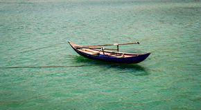 Simple bamboo boat on the sea Royalty Free Stock Images