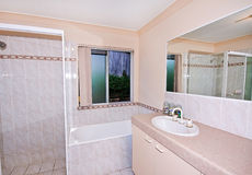 Simple Bathroom. A clean, modern but very basic bathroom in a townhouse Stock Photography