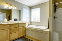 Simple bathroom interior with bath tub in the corner. Siimple bahtroom interior with bath tub in the corner and two windows Stock Photography