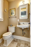 Simple bathroom interior in beige color Royalty Free Stock Photography