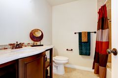 Simple bathroom interior in white and brown colors. Royalty Free Stock Image