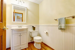 Simple bathroom with white vanity cabinet and hardwood floor. Simple bathroom interior with white vanity cabinet and hardwood floor. Northwest, USA Royalty Free Stock Images