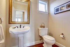 Simple bathroom with white walls. Royalty Free Stock Photography