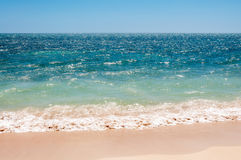 Simple beach shot at Playa Ancon in Cuba. Simple beach shot, only sand, sky, sea water and waves at the beautiful tropical beach called Playa Ancon in Caribbean Royalty Free Stock Photo