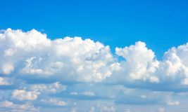 Simple beautiful gloomy blue sky with fluffy clouds in summer morning peace day as a background stock photo