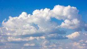 Simple beautiful gloomy blue sky with fluffy clouds in summer morning peace day as a background stock images