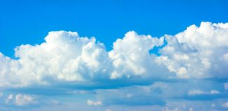 Simple beautiful gloomy blue sky with fluffy clouds in summer morning peace day as a background stock image