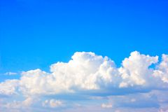 Simple beautiful gloomy blue sky with fluffy clouds in summer morning peace day as a background stock photography