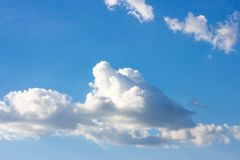 Simple beautiful gloomy blue sky with fluffy clouds in summer morning peace day as a background royalty free stock image