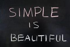 Simple is beautiful. Words written on blackboard royalty free stock image