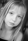 Simple Beauty. Young female child with bright eyes in black and white Stock Photo