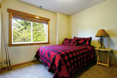 Simple bedroom in cabin style home. Stock Photography