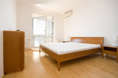 Simple bedroom. Picture of a simple bedroom Stock Image