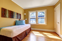 Simple Bedroom With Single Bed simple bedroom with single bed in colorful bedding stock photo