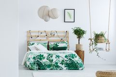 Simple bedroom with small tree stock photos